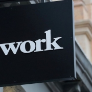 WeWork Parent Weighs Slashing Its Valuation in Half